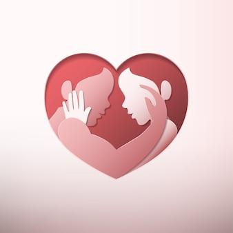 心の形のフレームの紙アートで愛撫のカップル