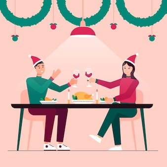 Пара празднует рождество с романтическим ужином