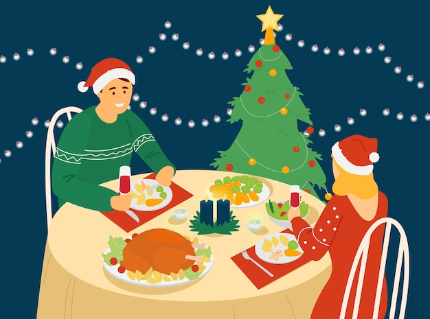 Couple celebrating new year or christmas sitting at table with christmas food.