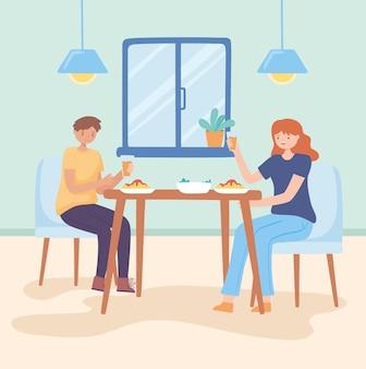 Пара обедает дома