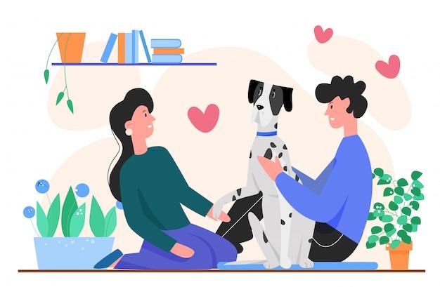 カップルの犬の所有者のイラスト。漫画フラット幸せな若い男性女性が犬を抱擁し、カップルのキャラクターが自宅のアパートで自分のペットの動物と一緒に時間を過ごす、白で隔離される動物への愛