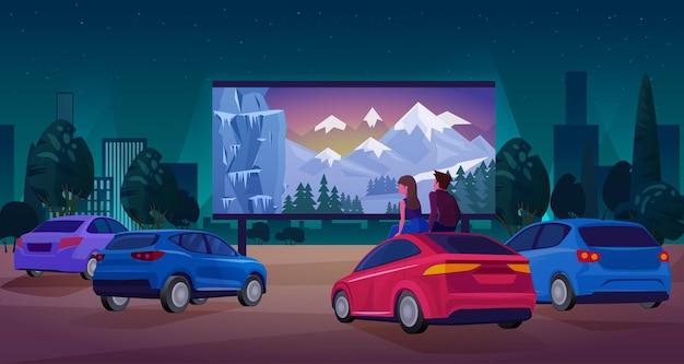 野外映画の大画面で映画を見ているカップルドライバーキャラクター