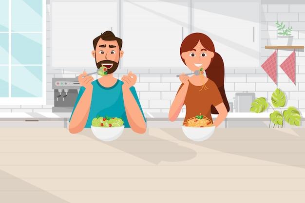 キッチンで食べ物、ベジタリアン、健康的なライフスタイルを食べるカップル
