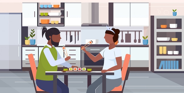 Couple eating sushi unhealthy lifestyle concept  overweight man woman sitting at table enjoying fast food modern kitchen interior flat portrait horizontal  illustration
