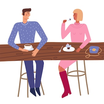 Couple enjoy romantic date eating cake and drinking coffee together happy man and woman sitting at t...