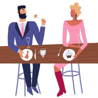 カップルは、スーツを着たレストランの男性とテーブルに座っているドレスを着た女性で一緒にロマンチックなデートを楽しんでいます...