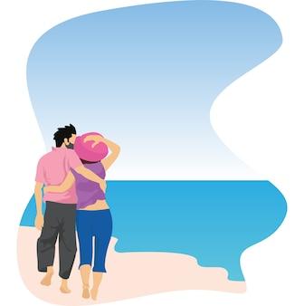 一緒にビーチで休暇を楽しんでいるカップル