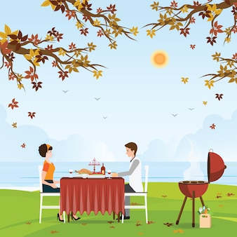 Couple grilling meat and picnic table.