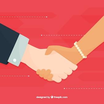 フラットスタイルでカップルの握手の背景