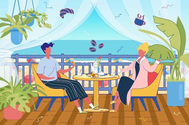 Couple having breakfast at resort terrace.