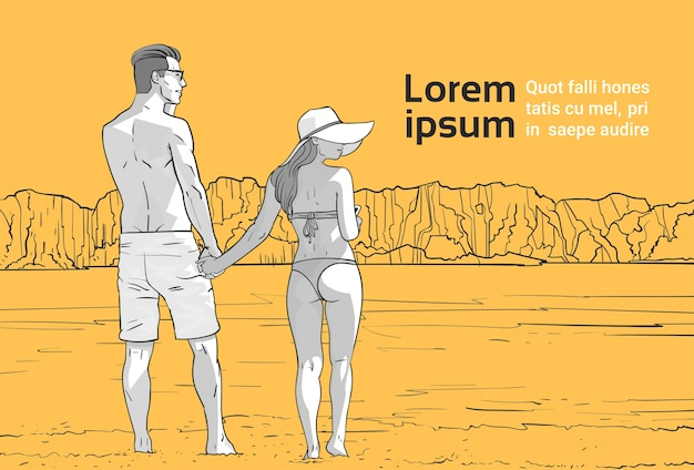 Couple hold hands on beach