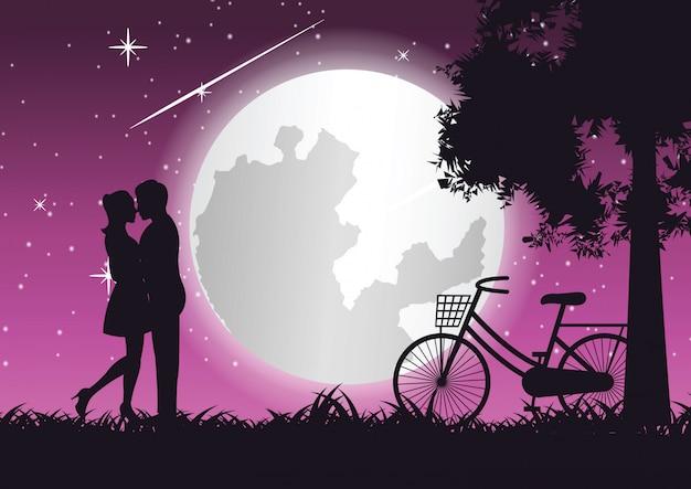カップルが一緒に抱擁し、自転車の近くにキスします。