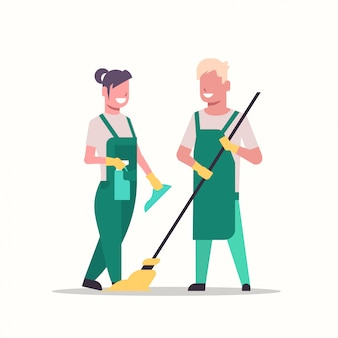 Couple janitors man woman in uniform cleaning service cleaners holding mop and spray plastic bottle working together