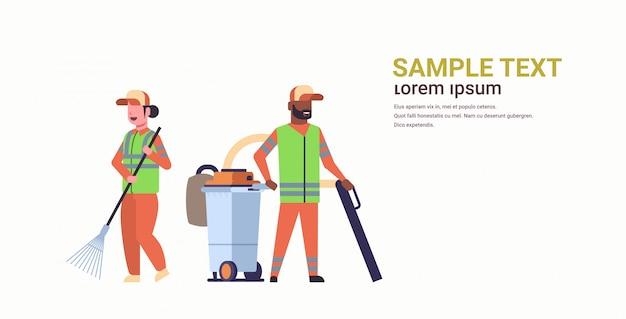 Couple janitors team gathering trash man using vacuum cleaner