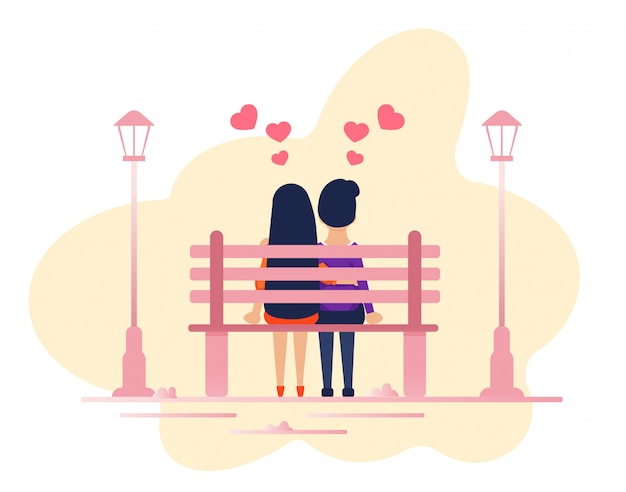 Couple in love sitting together on park bench
