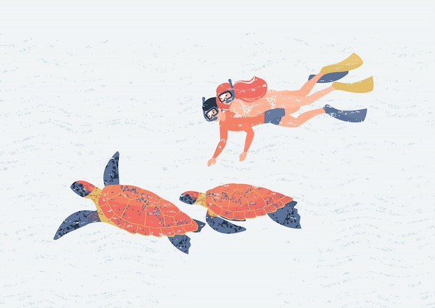 Couple of lovers swim underwater with a pair of turtles