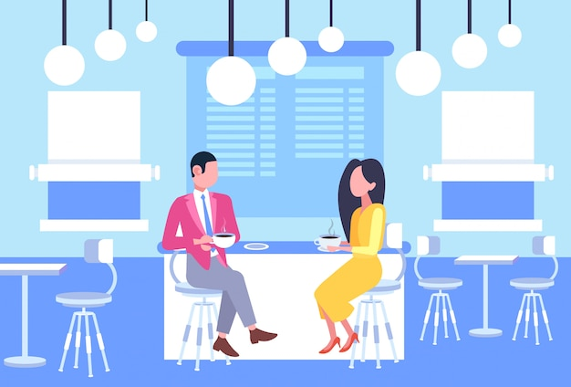 Couple man woman coworkers sitting at cafe table business people having informal meeting in coffee shop discussing relationship concept full length horizontal
