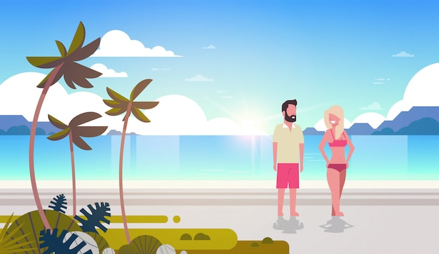 Couple man woman sunrise tropical palm beach summer vacation smiling walking seaside sea ocean