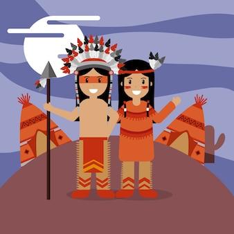 Пара родной американец в традиционном костюме