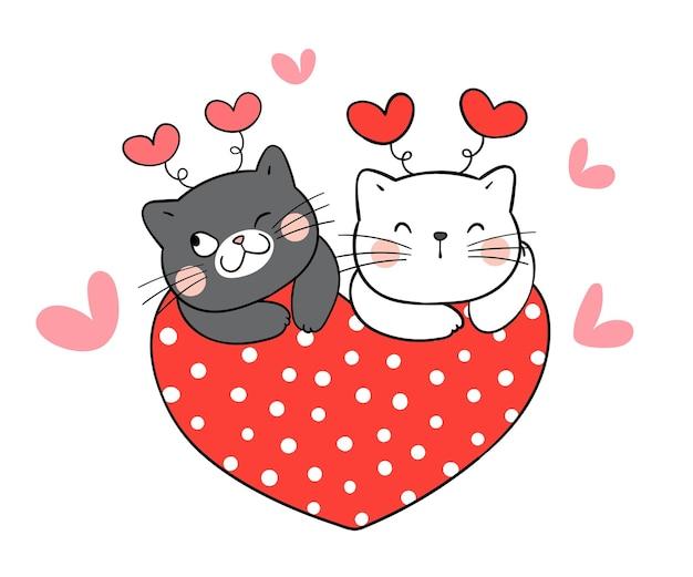 バレンタインの赤いハートと猫のカップル。