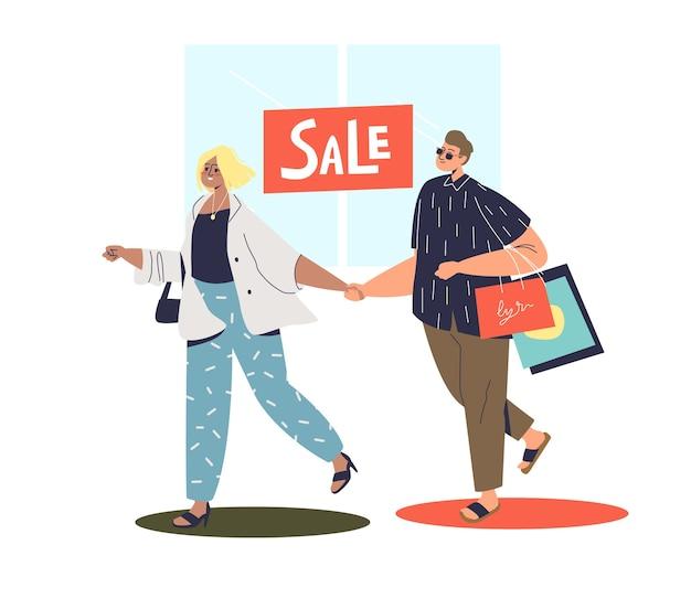 Пара хипстеров делает покупки во время продажи.