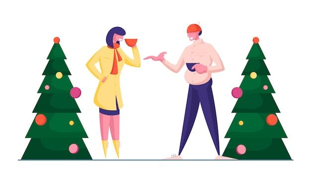 暖かい会話が立っている冬の服を着た男女のカップル