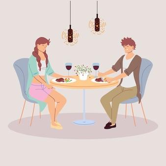 Пара человек обедает в ресторане
