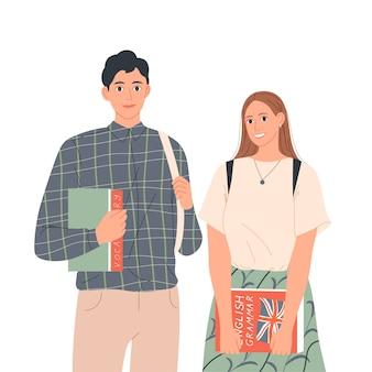 本を持った学生のカップルが隣同士に立っています。英語を学ぶ、教育。