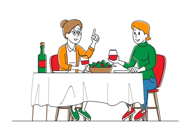 Пара молодых и пожилых женщин, сидящих за столом