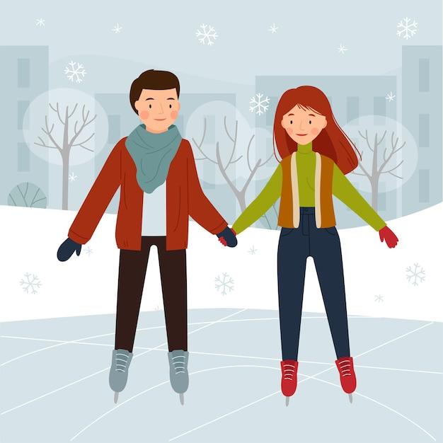公園のスケートリンクのカップル男の子と女の子のアイススケート
