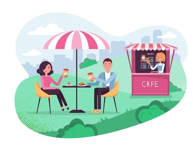 주말 데이트 커플. 사람들은 야외 거리 카페에서 햄버거와 커피를 마신다. 공원