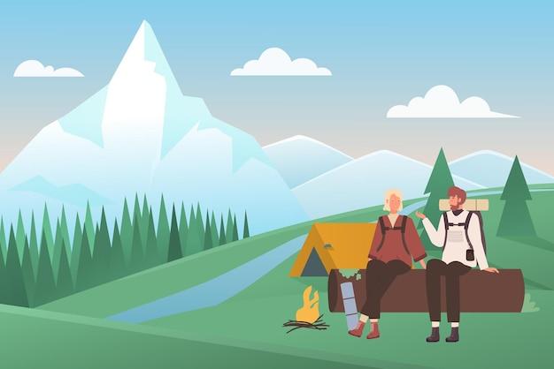 キャンプ場でテントとキャンプファイヤーのそばに座っているカップル Premiumベクター