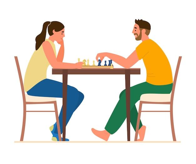 Пара играет в шахматы за столом у себя дома.