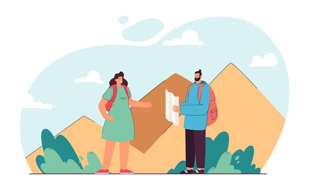 ハイキングのためのルートを計画しているカップル