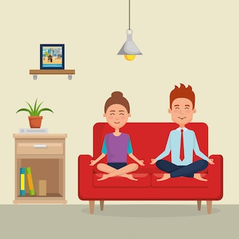 Couple practicing yoga on the sofa