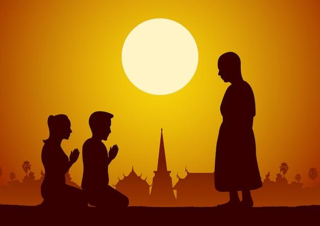 Couple pray respect to monk