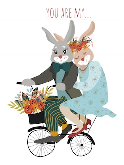 A couple of rabbits in love on a bicycle with a bouquet of flowers
