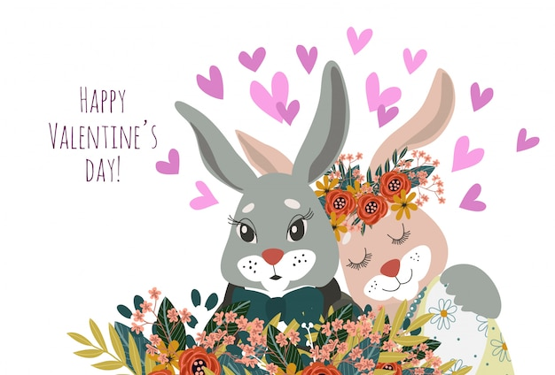 Couple of rabbits in love close-up with flowers and hearts