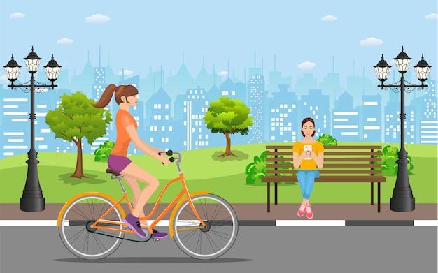 公園で自転車に乗るカップル、