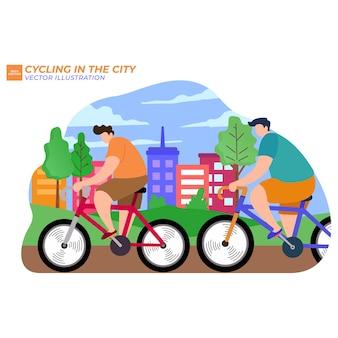 公共の場で自転車に乗るカップル