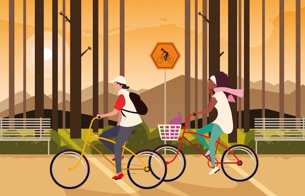 Couple riding bike and forest landscape with signage for cyclist