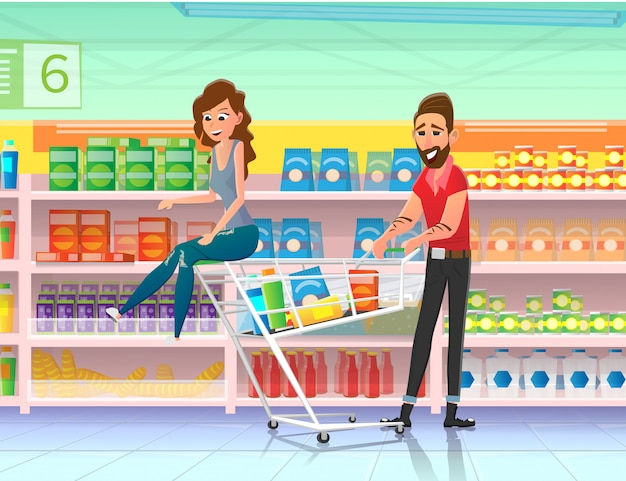 Couple riding shopping cart in supermarket flat.