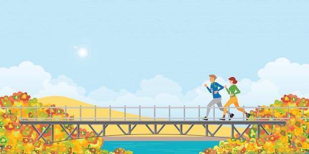 Couple running on bridge in autumn.