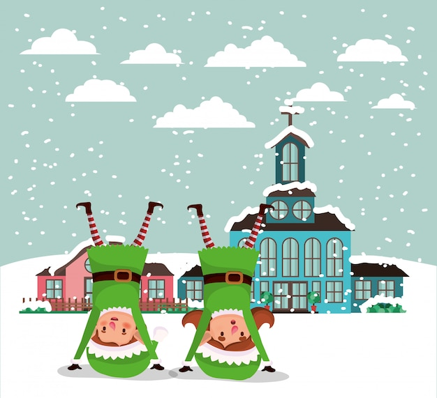 Couple santa helpers in snowscape