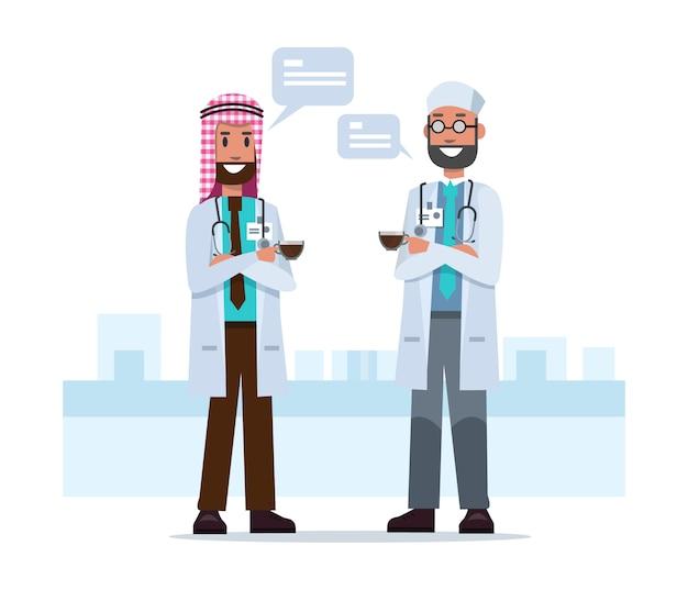 Couple saudi arab doctors talking in coffee break time.