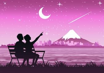 Couple sit near Fuji mount to look stars