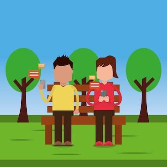 ベンチに座っているカップルは、メッセージを送信する公園をチャット