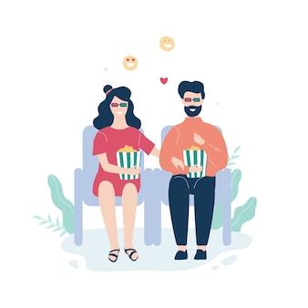 映画館で座っているカップルと3 dメガネで映画を見る