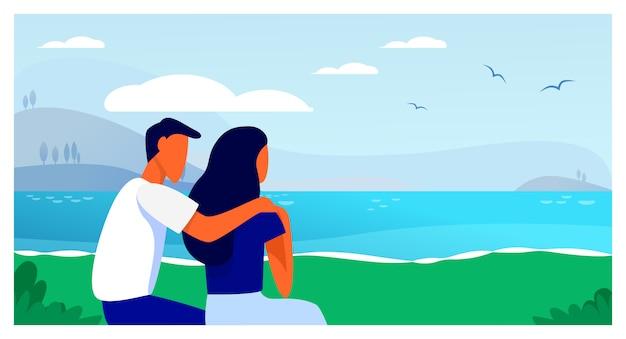 ビーチに座っているカップル