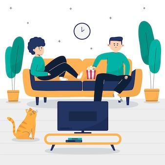 ソファに座って映画を見ているカップル